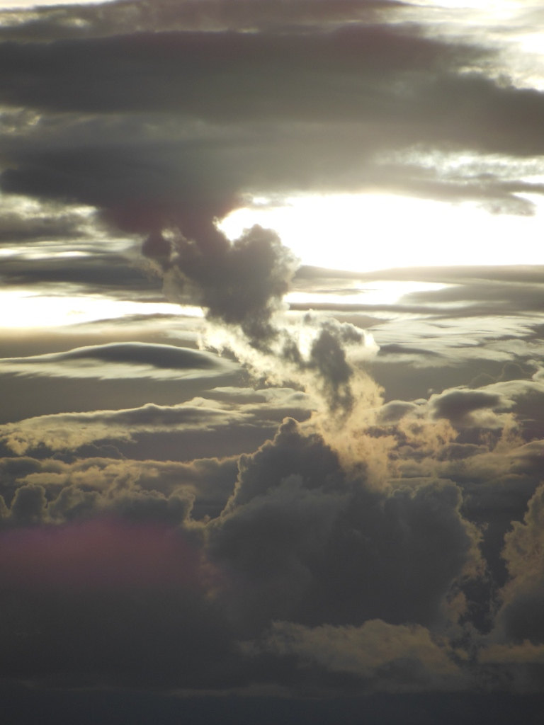 The sun and the clouds dance together