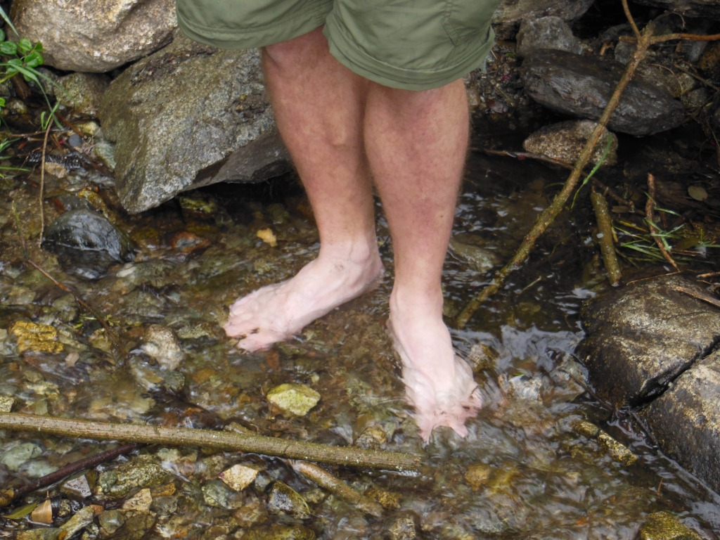 Ahh the cold water relieves the pain in the feet.